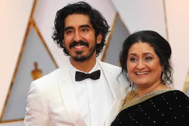 Actor Dev Patel and his mother at the Oscars.