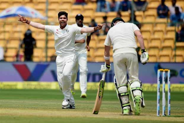 The second Test in Bengaluru ended in controversy after Steve Smith was caught by Virat Kohli while looking towards the dressing room balcony for advice on the DRS appeal against his dismissal. Photo: PTI