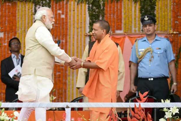Prime Minister Narendra Modi congratulates newly sworn-in chief minister of Uttar Pradesh, Yogi Adityanath, at the oath ceremony in Lucknow on Sunday. Photo: PTI
