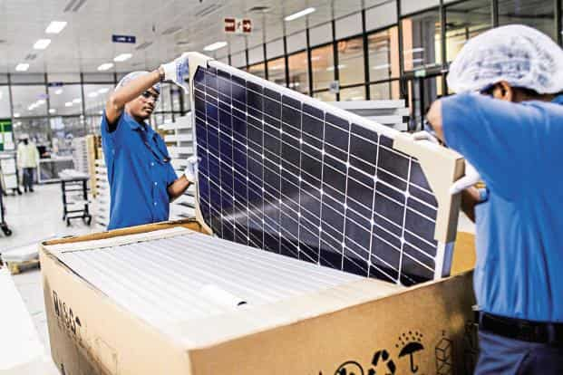 India is working on a plan to make local manufacturing of solar power equipment competitive, attracting foreign investments. Solar power tariffs have declined sharply because of plunging prices of solar modules. Photo: Bloomberg