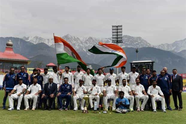 Virat Kohli with team mates and officials pose for a group photo after winning the series against Australia on the 4th day of last test match at HPCA Stadium in Dharamsala on Tuesday. PTI
