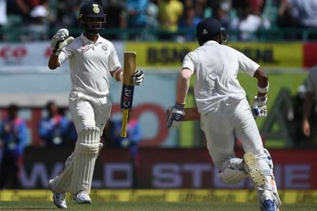 Lokesh Rahul (right) hit an unbeaten half-century to help India register a comprehensive eight-wicket victory over Australia. AFP