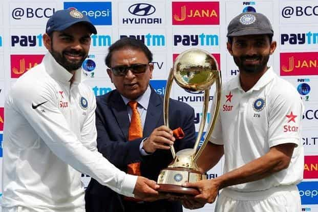 Needing just 106 runs to win with all 10 wickets intact at the start of the fourth day, India eased past their target before lunch for the loss of just two batsmen. (Above) Virat Kohli (left) and Ajinkya Rahane (right) receive the trophy from Sunil Gavaskar (centre) after winning the series. Reuters