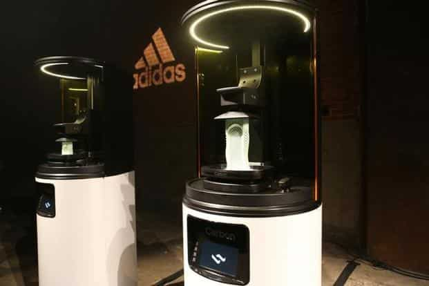 b6c937c5a ... Carbon 3D printing machines are seen at an unveiling event for the new Adidas  Futurecraft shoe