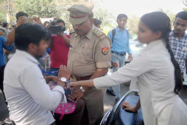 A UP policeman accosts a youth as part of an 'anti-Romeo squad' drive. The new UP DGP, Sulkhan Singh, has said there will be no compromise in ensuring security to the common man. Photo: PTI