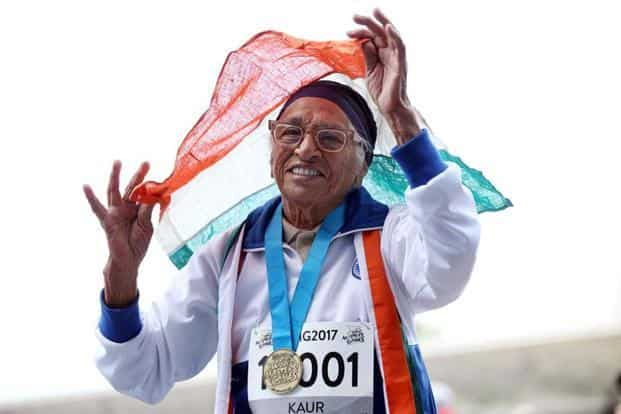 101-year-old Man Kaur celebrates winning the 100 metres sprint at the World Masters Games in Auckland on Monday. This is the 17th gold medal in the athlete's remarkable late-blooming career. Photos: Michael Bradley/AFP