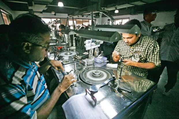 Employees work inside the polishing department of a diamond processing unit at Surat, Gujarat. Photo: Reuters