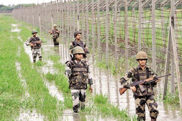The BSF personnel patrolling on the fence at International Border at Suchetgarh about 30km from Jammu, India. Photo: Hindustan Times