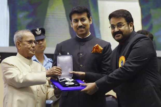 President Pranab Mukherjee presents Special Jury Award to Malayalam actor Mohan Lal for 'Janatha Garage', 'Pulimurugan' and 'Munthirivallikal Thalirkkumbol'. PTI