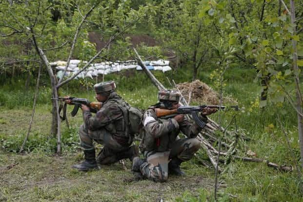 Soldiers (above) take position inside an apple orchard during a search operation in Shopian. The operation comes four days after militants killed seven people, including five policemen, in adjoining Kulgam. Mukhtar Khan/AP