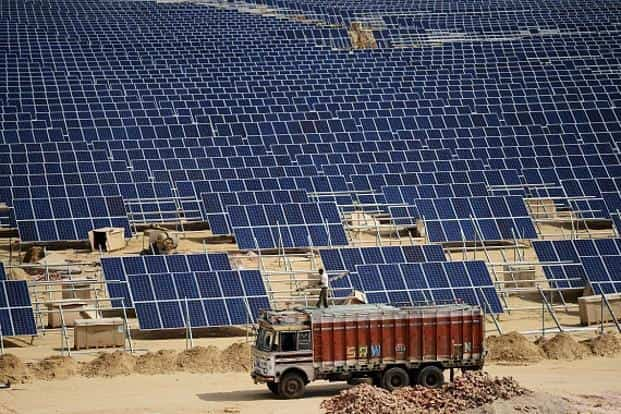 State-run Solar Energy Corporation of India (SECI) is conducting the auction of Bhadla solar parks in Rajasthan. Photo: AFP