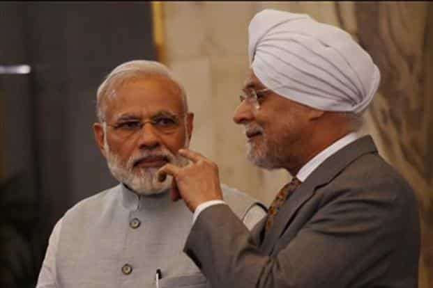 A file photo of PM Narendra Modi and chief justice of India J.S. Khehar (right). Khehar said the system will ensure transparency, provide easy access to case information and help in reducing the time in filing pleadings. Photo: PTI