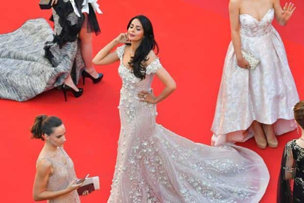 Cannes regular Mallika Sherawat poses upon arrival at the screening of 'Ismael's Ghosts' on 17 May. AFP