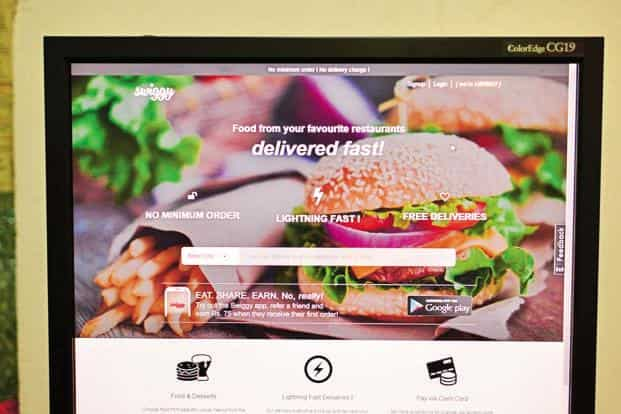 While Zomato offers restaurant listings and food delivery, Swiggy is purely into food delivery business. Photo: Pradeep Gaur/ Mint