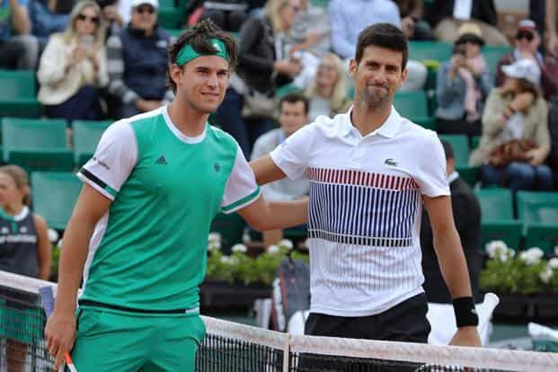 Austria's Dominic Thiem, left, poses with Serbia's Novak Djokovic before their tennis quarterfinal match at the Roland Garros 2017 French Open on Wednesday in Paris. Djokovic lost to sixth-seeded Thiem by 7-6 (5), 6-3, 6-0.  Photo: AFP