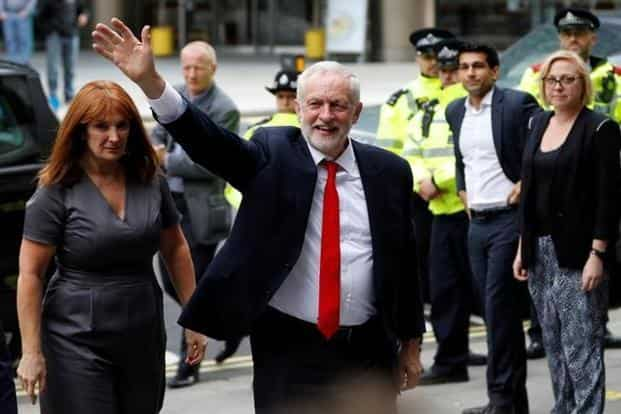 Jeremy Corbyn, leader of Britain's opposition Labour Party, arrives at the party's headquarters in London on Friday. Photo: Darren Staples/Reuters
