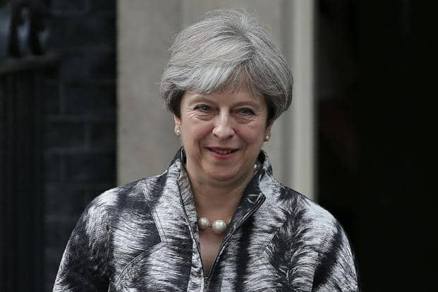 At a private meeting with rank-and-file lawmakers Monday evening Theresa May pledged to consult the party more over policy. Photo: Bloomberg