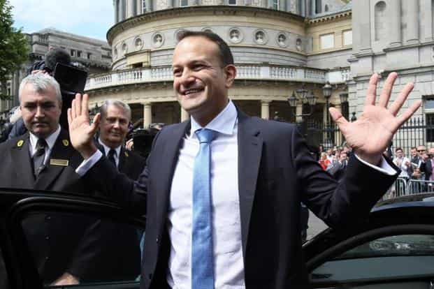 73b7ce37e ... Leo Varadkar waves to colleagues as he leaves the parliament in Dublin  after being confirmed as