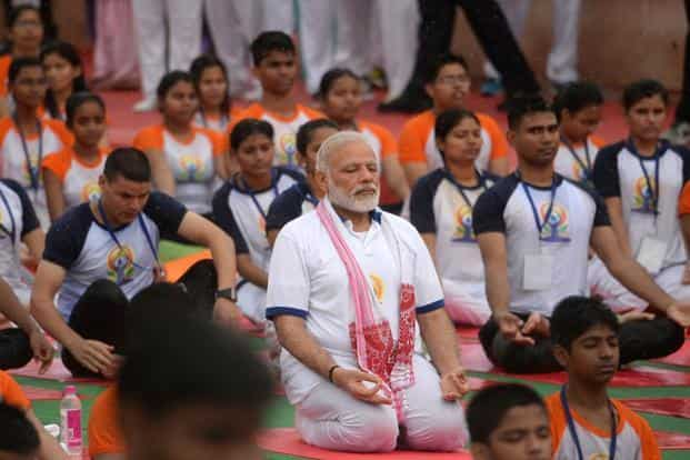 Prime Minister Narendra Modi participates in a mass yoga session at Ramabhai Ambedkar Sabha Sthal in Lucknow. AFP