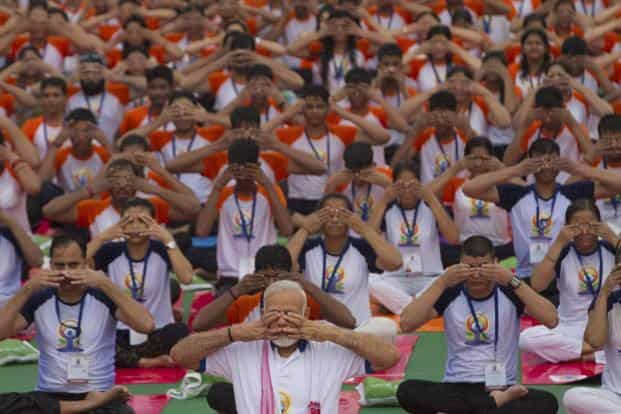 Prime Minister Narendra Modi leads the yoga session in Lucknow. AFP