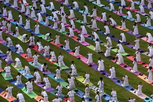 Students take part in a yoga session in Chennai. AFP