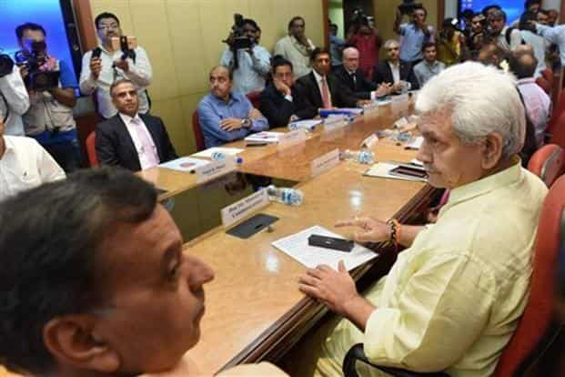 Telecom minister Manoj Sinha (left) during the meeting with telecom leaders in Delhi on Thursday. Photo: PTI