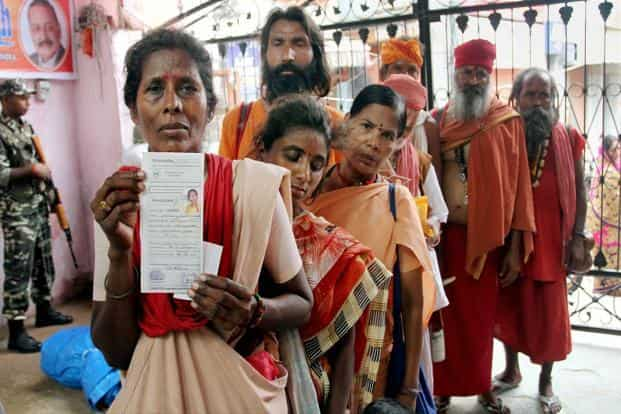 Pilgrims wait to get themselves registered for the yatra at Ram Mandir base camp in Jammu. PTI