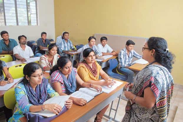In India, parents fund their children education from day to day income, general savings, education investments or a combination of such factors. File photo: Hemant Mishra/Mint