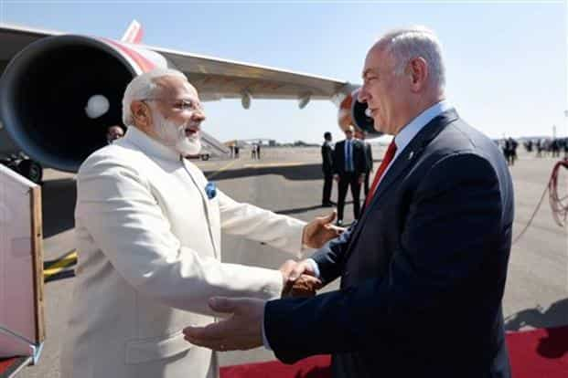 Prime Minister Narendra Modi (left) being received by Israel PM Benjamin Netanyahu, on his arrival, at Ben Gurion Airport, in Tel Aviv on Tuesday. Photo: PTI/PIB