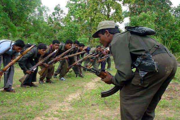 A file photo of armed Maoist rebels at a training camp in the jungles of Chhattisgarh in 2006. Photo: AP