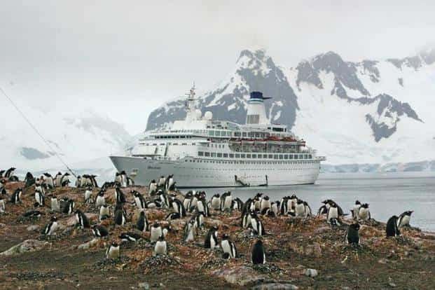 A ship passing through the Antarctic Peninsula. Photo: iStockphoto