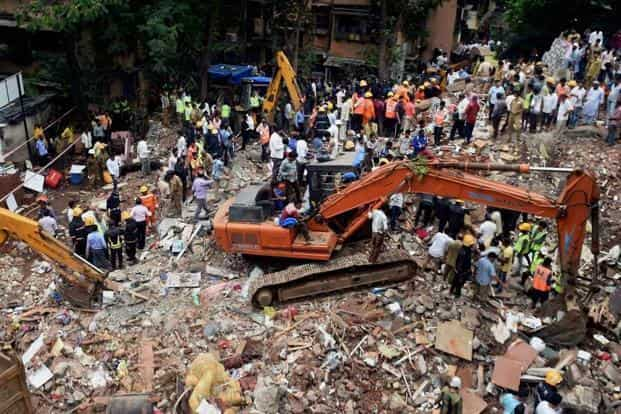 Rescue workers search for survivors at the site of the collapsed building at Ghatkopar in Mumbai on Tuesday. PTI