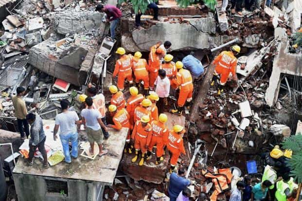 Fire brigade and NDRF personnel carry out rescue work following a building collapse at Ghatkopar in Mumbai on Tuesday. PTI