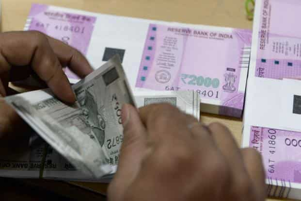 The rupee opened at 64.12 a dollar and touched a high of 63.60. So far this year it gained over 6.5%. Photo: AFP