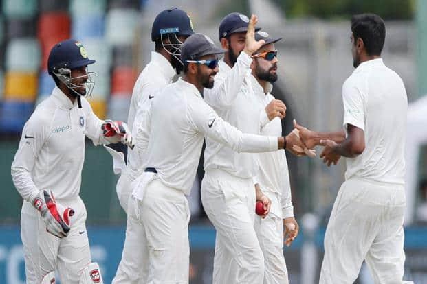 Ravichandran Ashwin celebrates with captain Virat Kohli and teammates after taking the wicket of Sri Lanka's Angelo Mathews in 2nd Test Match,  Colombo. Photo: Reuters