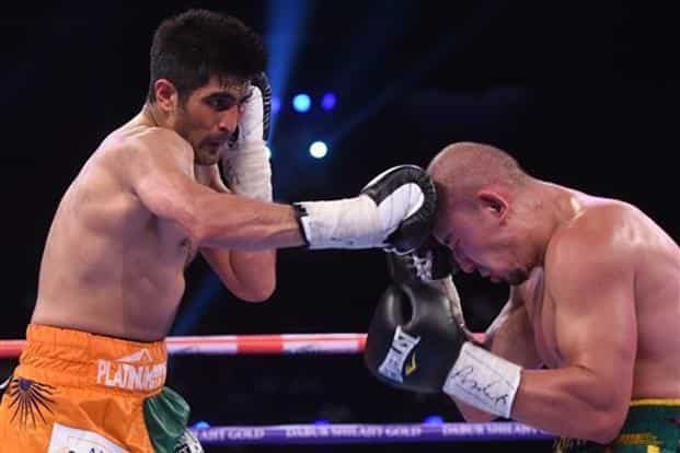 Indian boxer Vijender Singh in action against the Chinese boxer Zulpikar Maimaitiali during their bout in Mumbai on Saturday. Photo: PTI