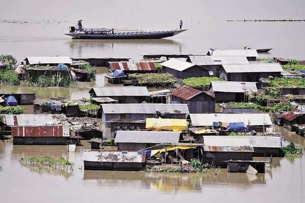 A July photo of a flood-affected village in Assam's Morigaon district.Till 6 August, 29 of the state's 33 districts had been hit by floods, killing 84 people and displacing 2.5 million. Photo: Reuters
