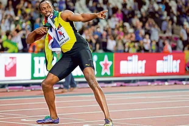 Usain Bolt strikes his signature pose. Photo: AP