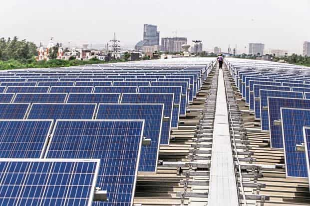 Solar energy offers an opportunity for around 304 million Indians who don't have electricity access. Photo: Bloomberg