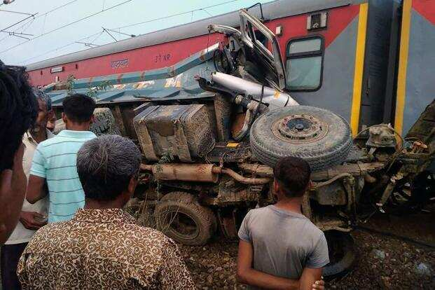 A sand dumper trespassing railway tracks caused derailment of Kaifiyat Express in Auriya, Uttar Pradesh on Wednesday. AFP