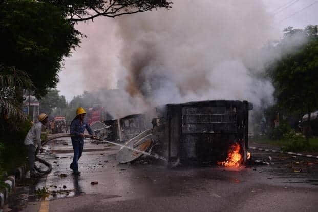 Vehicles burnt in violence following Dera Sacha Sauda chief Gurmeet Ram Rahim's conviction in Panchkula on Friday. Photo: Pradeep Gaur/Mint