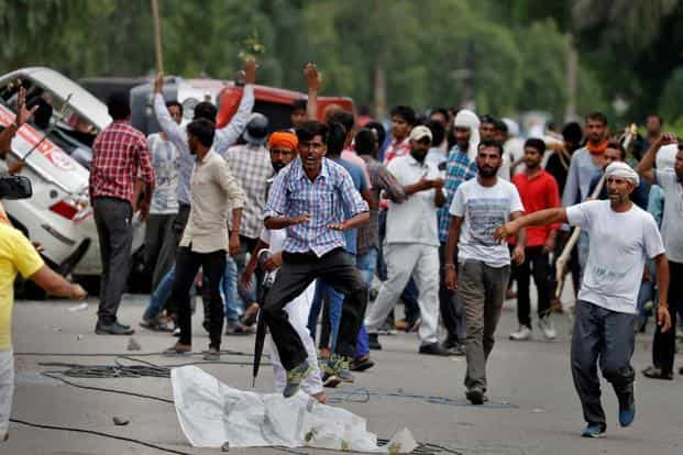Protestors in Panchkula after Dera chief Gurmeet Ram Rahim Singh was convicted in a rape case on Friday. Photo: Reuters.