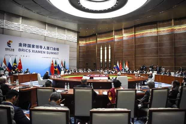 The plenary session of the Brics Summit on Monday. Xi wants Brics to play a bigger role in world governance and reject protectionism. AP