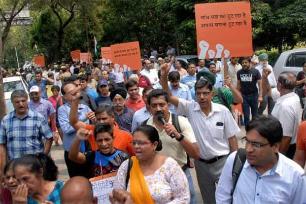 Jaypee Infratech homebuyers raise slogans and hold placards during a protest in Noida on Saturday. Jaypee Infratech has defaulted on Rs526.11 crore of loans outstanding to IDBI Bank. Photo: PTI