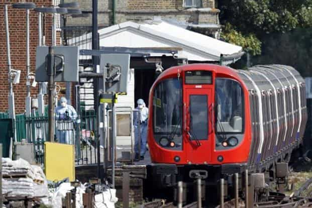 Police forensics officers works alongside an underground tube train at a platform at Parsons Green underground tube station in west London on 15 September 2017, following an incident on an underground tube carriage at the station. Photo: AFP
