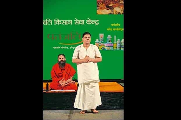 Patanjali Ayurved founder Baba Ramdev with group CEO and managing director Acharya Balakrishna. In August, Patanjali had announced its intention to borrow Rs1,000 crore to finance its expansion plans. Photo: Pradeep Gaur/Mint