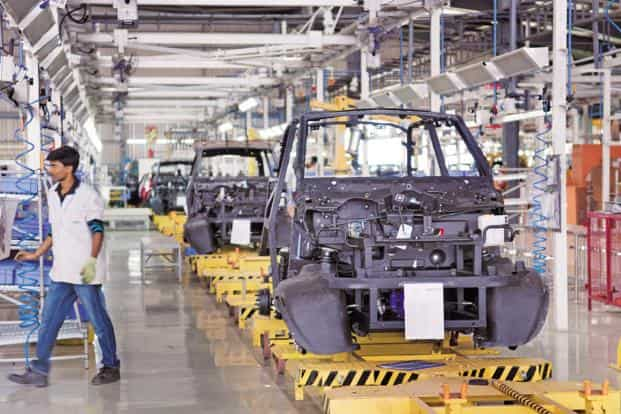 A File Photo Of An Electric Car Manufacturing Plant Energy Efficiency Services Has Extended The