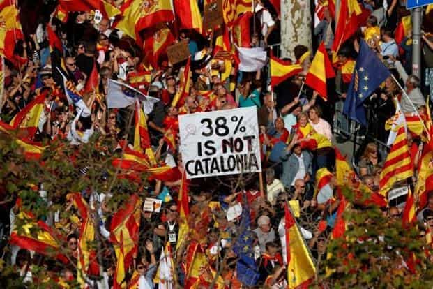 Pro-unity supporters take part in a demonstration against Catalonia's declaration of independence in central Barcelona, Spain, on Sunday. Reuters