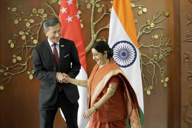 Indian foreign minister Sushma Swaraj (right) shakes hand with her Singapore counterpart Vivian Balakrishnan in New Delhi on Tuesday. Photo: AP