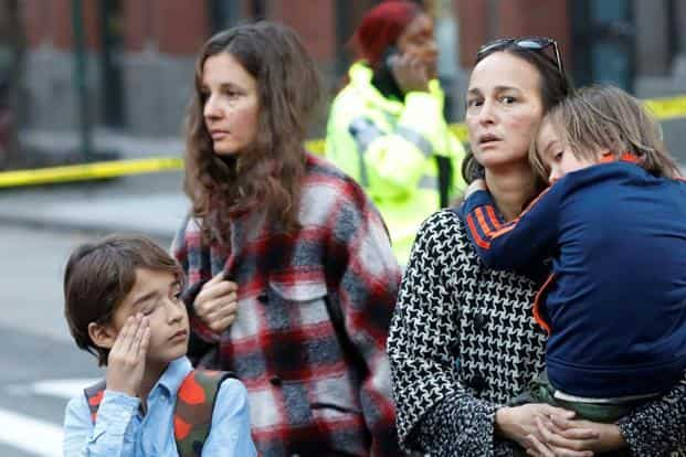 Parents arrive to pick up children outside a school near the attack site on Tuesday. Reuters